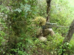 airsoft sniper in woods